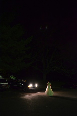 This was the last photo I took on the evening of the wedding. It was after 9pm, and the bride was gathering her things to go. I watched her walk out into the parking lot and the headlights of a parked car illuminated her dress. I took the shot. Holly and Steve's Wedding